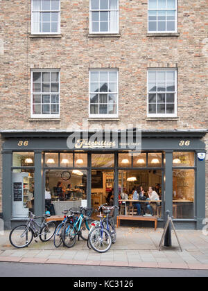 The new Fitzbillies restaurant and cafe in Bridge Street Cambridge UK at dusk with interior lights glowing - Stock Photo