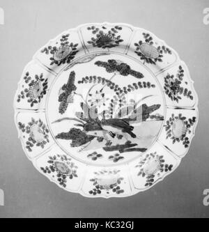 Plate, Ming dynasty (1368–1644), China, Porcelain, H. 1 in. (2.5 cm); Diam. 7 3/4 in. (19.7 cm); Diam. of foot 4 - Stock Photo