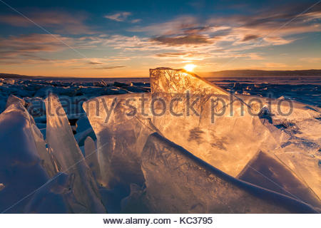 Colorful sunset over the crystal ice of Baikal lake - Stock Photo
