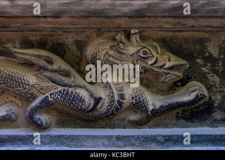 Kyoto, Japan - May 18, 2017: Wood carved dragon in the roof to protect the temple - Stock Photo