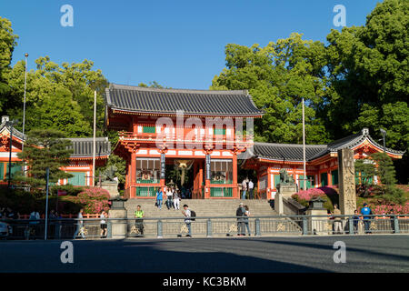 Kyoto, Japan - May 18, 2017: Main gate of the Yasaka jinja shrine in Kyoto with visiting tourists on the stairs - Stock Photo
