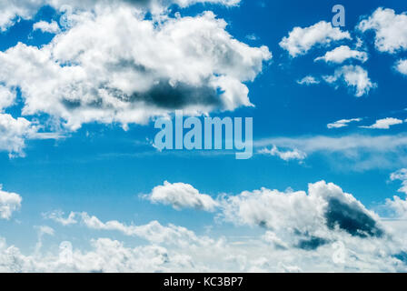 Blue sky with many white clouds. Photo with noise - Stock Photo