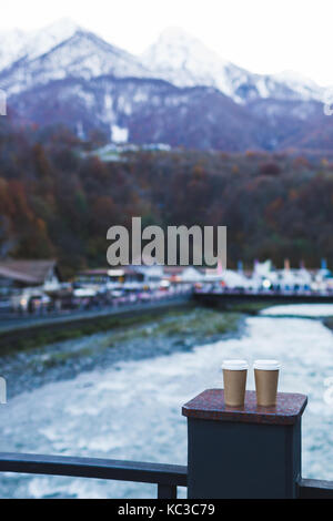 Two takeaway coffee cups with mountainwiev - Stock Photo