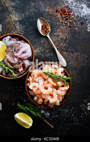 seafood in bowls and on a table - Stock Photo