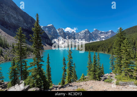 Moraine lake with beautiful turquoise water and snow-covered peaks in Banff National Park, Canada - Stock Photo