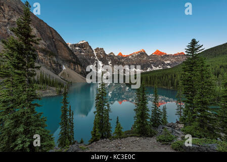 Sunrise at Moraine Lake in Banff National Park, Canada. - Stock Photo