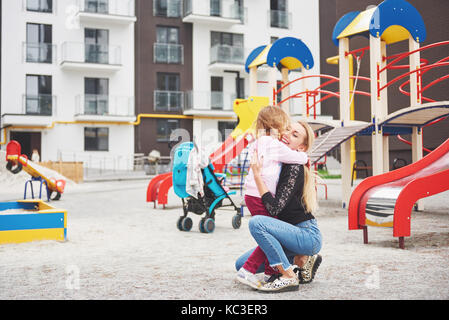 mother with child on the playground - Stock Photo