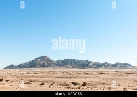 The Rossing Mountain as seen from the B2-road between Swakopmund and Arandis in the Namib Desert of Namibia - Stock Photo