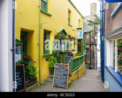 The Plantagenet House restaurant and Tudor Merchant's House on narrow lane. Quay Hill, Tenby, Pembrokeshire, South - Stock Photo