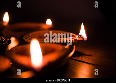 Diya in Thali - Brass Plate or thali full of Terracotta diya or oil lamps ready for decorating or illuminating house - Stock Photo