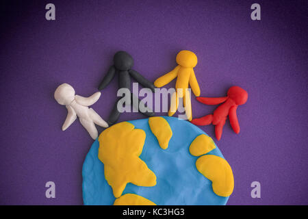 Group of people around the world. People and Earth are made out of play clay (plasticine). - Stock Photo