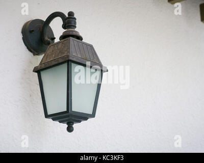 Vintage old wall lantern in close up view - Stock Photo