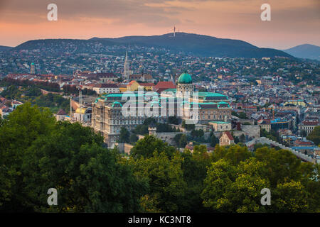 Budapest, Hungary - Panoramic skyline view of the famous Buda Castle Royal Palace with the Buda Hills and Matthias - Stock Photo