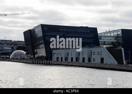 The modern diamond shaped library called the Black Diamond is a waterfront extension to the Royal Danish Library's - Stock Photo