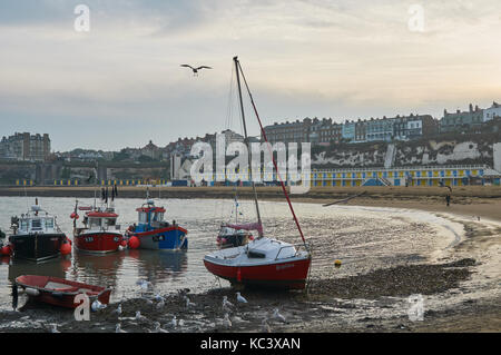 Broadstairs Beach, Thanet, East Kent, UK, in the early evening, with boats and seagulls - Stock Photo