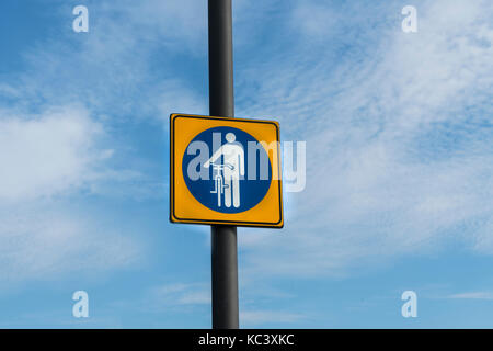 an indication sign to drive the bicycle by hand - Stock Photo