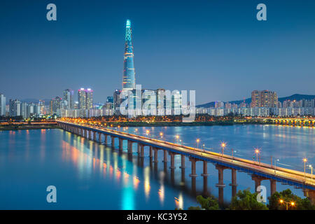 Seoul. Cityscape image of Seoul and Han River during twilight blue hour. - Stock Photo
