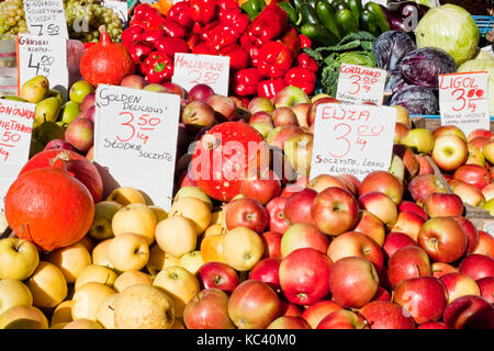 Apples, pumpkins and other fruits and vegetables for sale on a market in Warsaw, Poland - Stock Photo