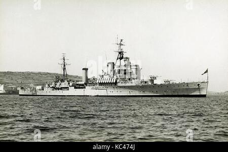Antique c1940 photograph, HMS Jamaica (C44). HMS Jamaica, a Crown Colony-class cruiser of the Royal Navy, was named - Stock Photo