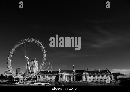 black and white image of the London eye in summer time - Stock Photo