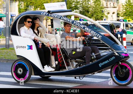 Germany, Cologne, rickshaw for sightseeing at the Heumarkt  Deutschland, Koeln, Fahrrad-Rikscha fuer Stadtrundfahrten - Stock Photo