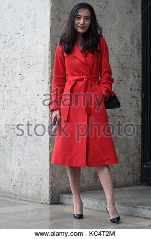 Street Style during Paris Fashion Week Spring Summer 2018 on Sunday 1st October 2017. Image shows a woman in a red - Stock Photo