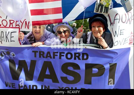 Manchester, UK. 3rd Oct, 2017. WASPI (Women Against State Pension Inequality) campaigners, many in Victorian Suffragette - Stock Photo