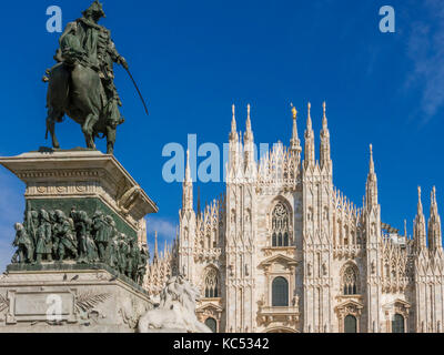 Equestrian statue of Vittorio Emanuele II overlooking the Gothic cathedral in Piazza del Duomo in Milan, Milano, - Stock Photo