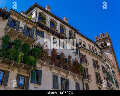 House façade at Piazza delle Erbe, Verona, Veneto, Italy, Europe - Stock Photo