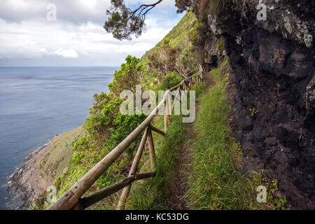 Hiking trail on the south coast near Faja de Lopo Vaz, island of Flores, Azores, Portugal - Stock Photo