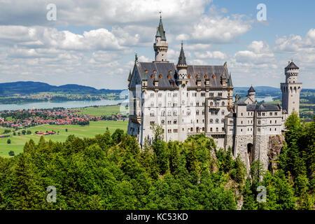 Neuschwanstein Castle, in the back Forggensee, Schwangau, East Allgäu, Allgäu, Swabia, Upper Bavaria, Bavaria, Germany - Stock Photo