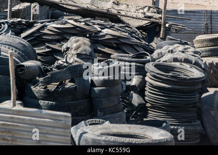 A pile of old rotten rubber tires in a garage in Gujarat, India - Stock Photo