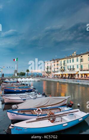 Harbour with fishing boats, Lazise, Lake Garda, Veneto, Veneto, Veneto, Italy - Stock Photo
