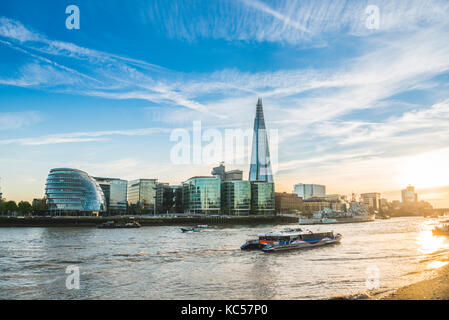 Riverside promenade on the Thames, Tower Pier, Skyline of the office complex More London Riverside, London City - Stock Photo