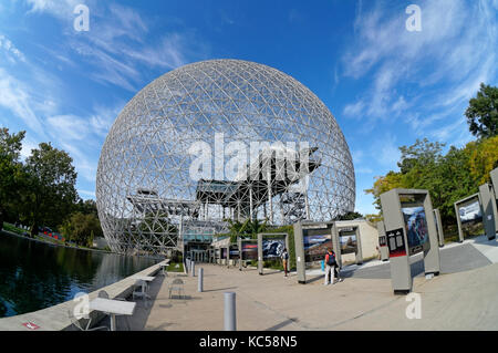 Tourists outside the Montreal Biosphere in Parc Jean Drapeau, Ile Sainte-Helene, Montreal, Quebec, Canada - Stock Photo