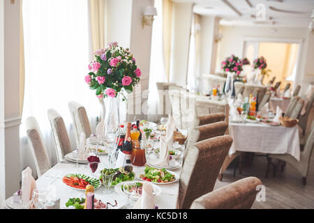 Plate at the wedding table,Wedding table settings. Wedding flower composition for guests tables - Stock Photo