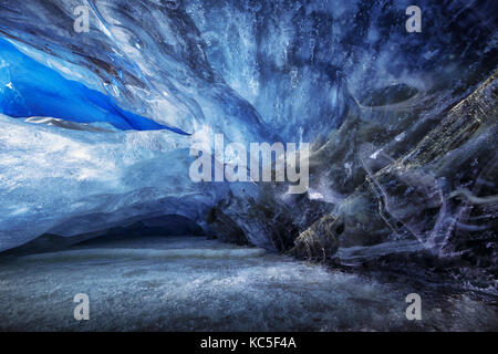 Ice shapes inside an ice cave during a photography expedition in Athabasca Glacier - Stock Photo