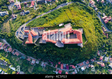 Aerial view of the Majestic Fortress - Palanok Castle towering above the city of Mukacheve, Ukraine. Top view, from - Stock Photo