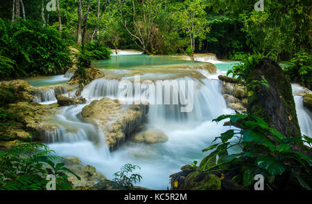 Kuang Si mountain waterfall in Luang Prabang, Laos - Stock Photo