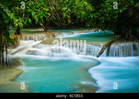 Turquoise water of Kuang Si waterfall in Luang Prabang, Laos - Stock Photo