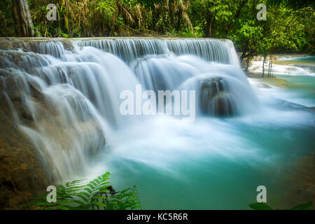 The Kuang Si waterfall in Luang Prabang, Laos - Stock Photo