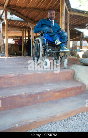 A man in a wheelchair is blocked access by using steps.CREATE CBR staff and delagates at the workshop and launch - Stock Photo