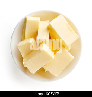 Butter pieces in bowl isolated on white background, top view - Stock Photo