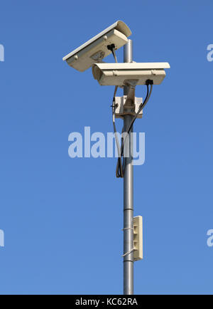 Closed-circuit camera with wifi repeater for city control - Stock Photo