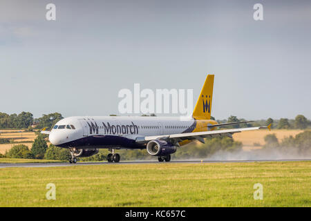 Monarch Airlines Airbus A321 G-OZBM taking off from a wet runway on August 18th 2017 at London Luton Airport, Bedfordshire, - Stock Photo