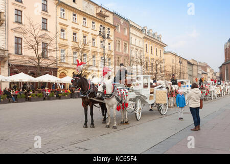 Horse and carriage rides, Main Square, Krakow, Poland - Stock Photo