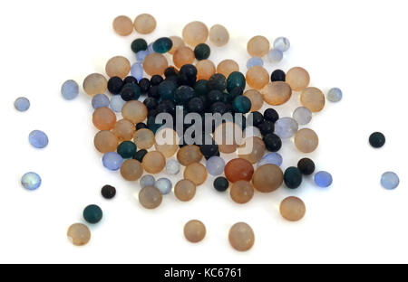Silica gel  used as absorbent of moisture over white background - Stock Photo
