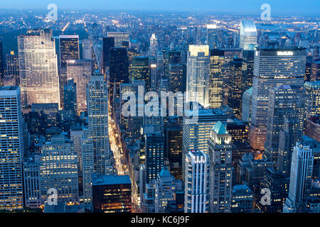 Manhattan New York skyline aerial view at sunset, with all the skyscrapers reflecting blue tones of light and turning - Stock Photo