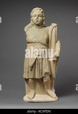 Limestone statuette of Dionysos holding a thyrsos, 310–30 B.C - Stock Photo