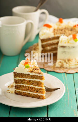 Piece of carrot cake with cream cheese frosting - Stock Photo